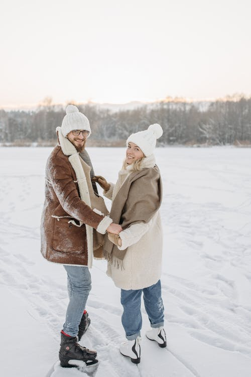 A Couple Wearing Ice Skates