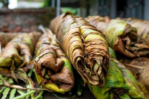 Ripe tobacco leaves heaped on market