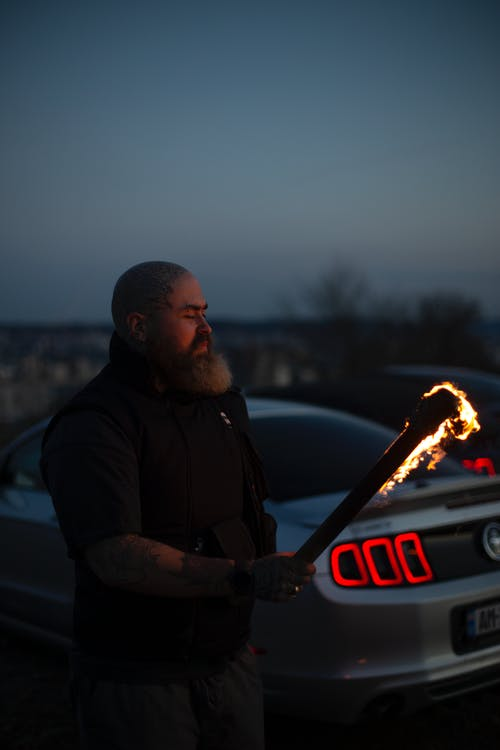 A Man Holding a Burning Torch