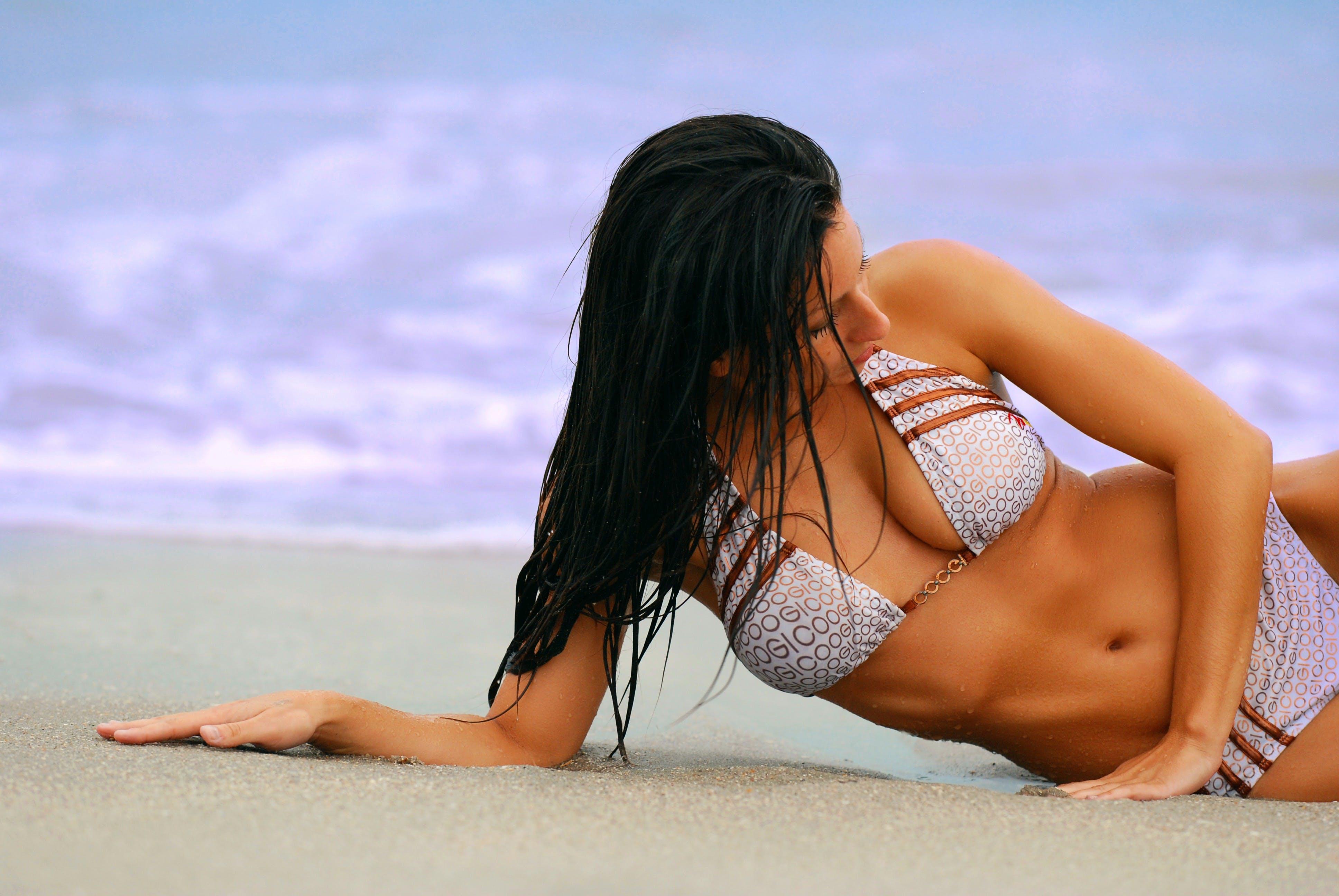 Woman Wearing White and Brown Bikini