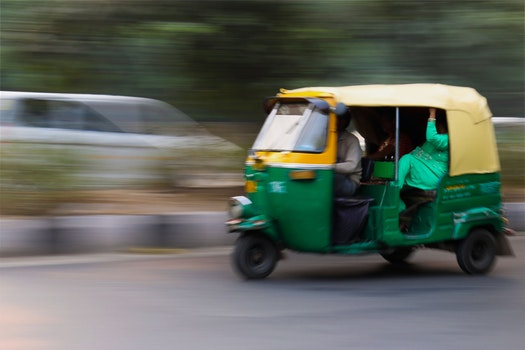 Green and Yellow 3 Wheeled Vehicle