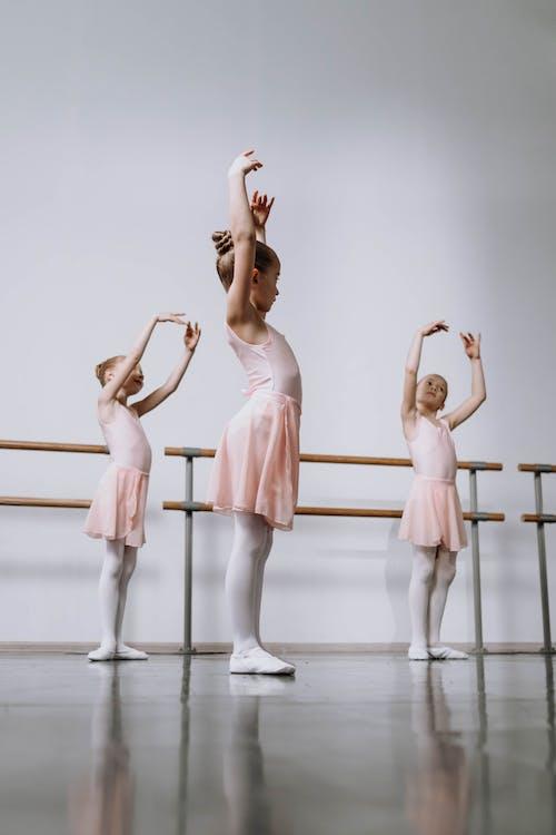 Ballet Dancers Practicing on a Ballet Studio