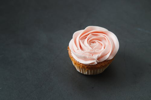 Close-Up Photo of a Cupcake with Rose Icing