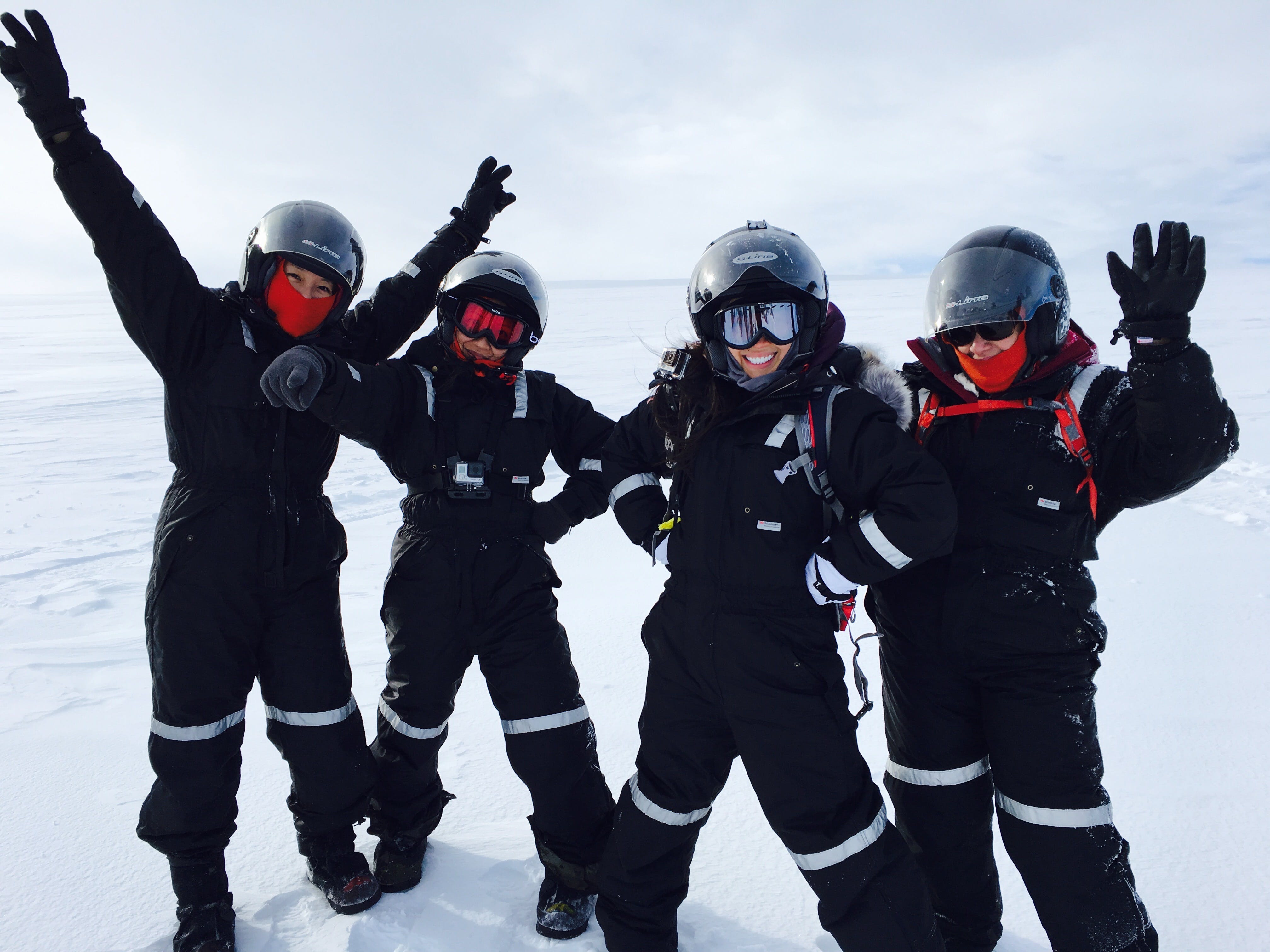 Four Person Wearing Black Snow Suit