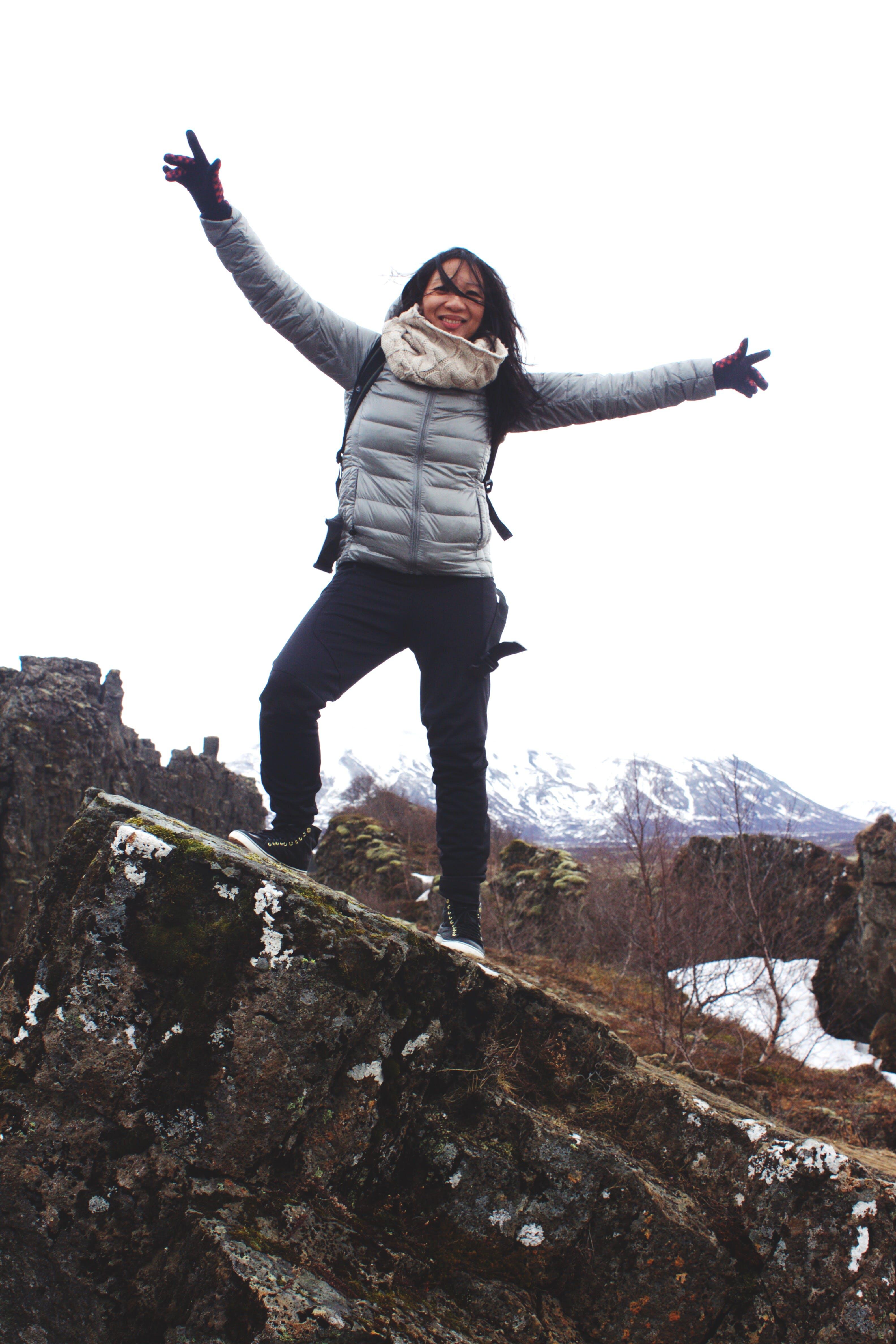 Woman Standing on a Rock Wearing Bubble Jacket