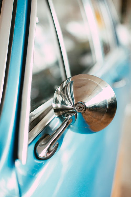 Silver Door Knob in Blue Car