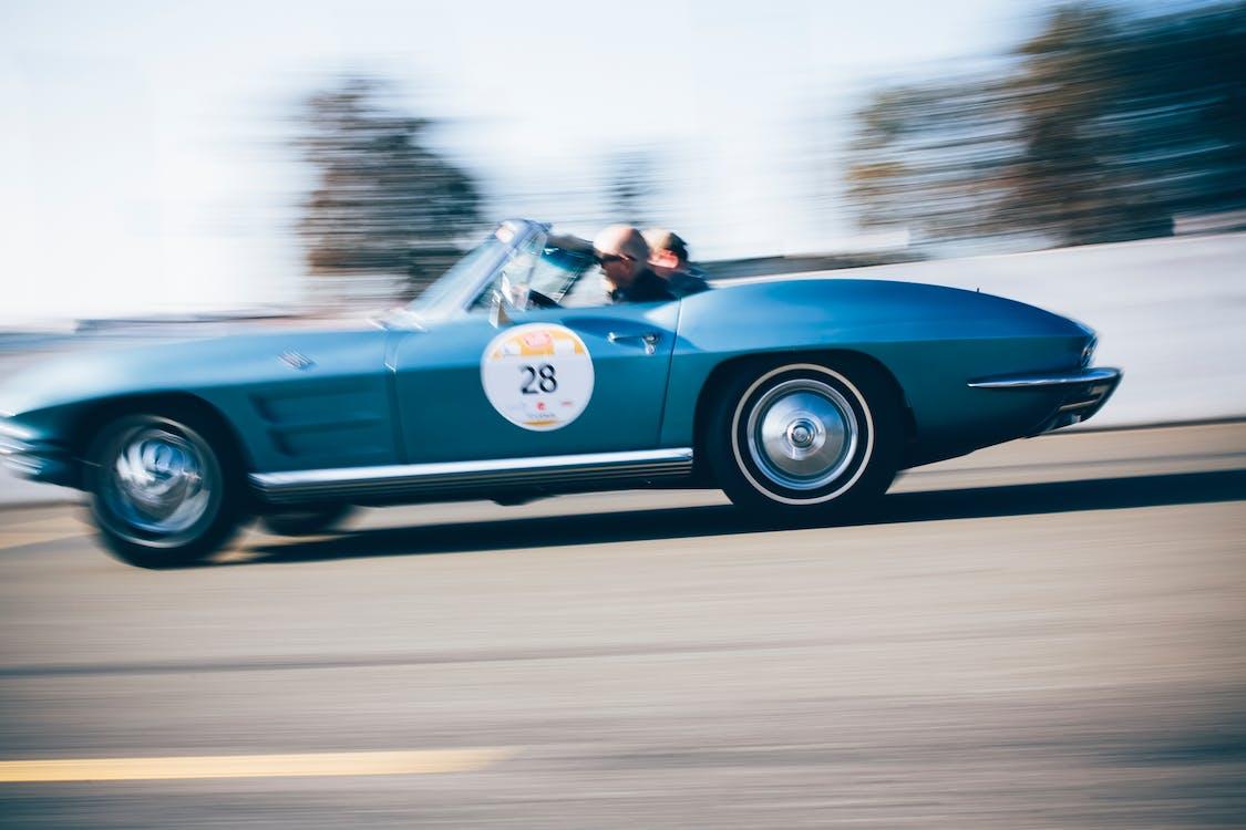 Man Driving Blue Porsche 911 Convertible