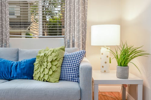 Blue Throw Pillow on White Couch