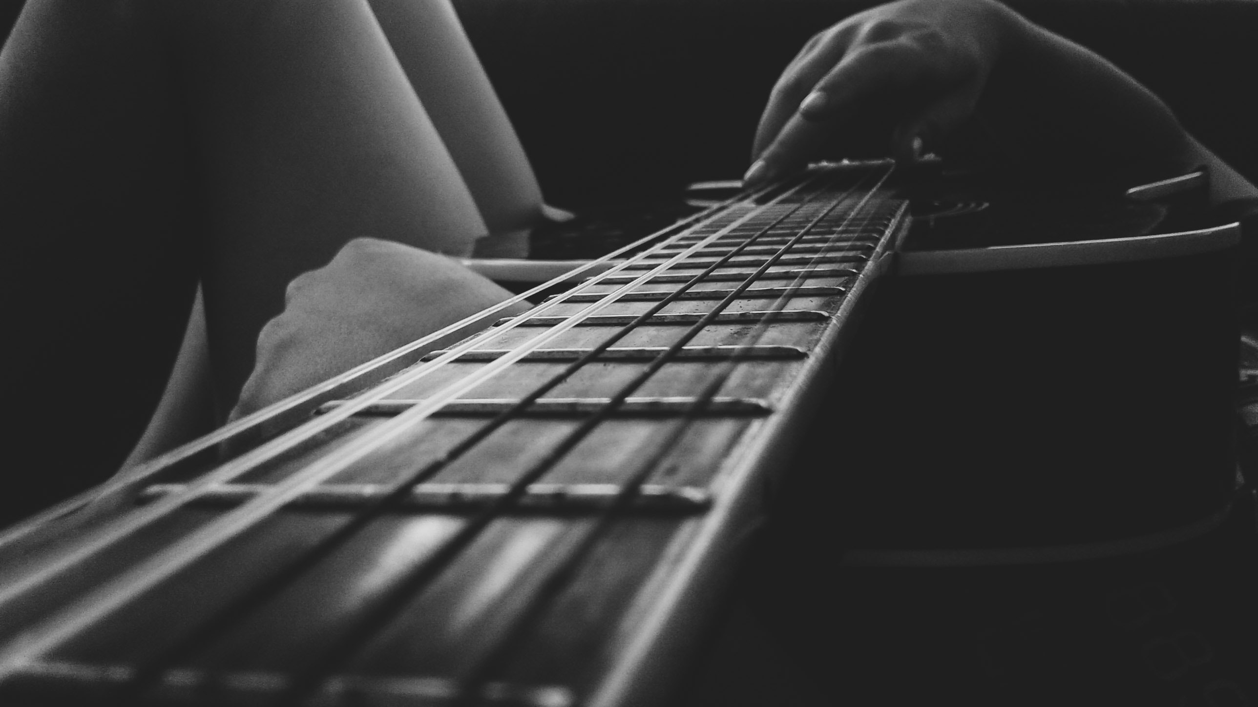 Person Holding An Acoustic Guitar Free Stock Photo