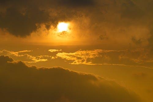 Dramatic cloudy sky in golden sunshine