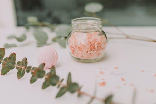 Clear Glass Jar With White Powder Inside