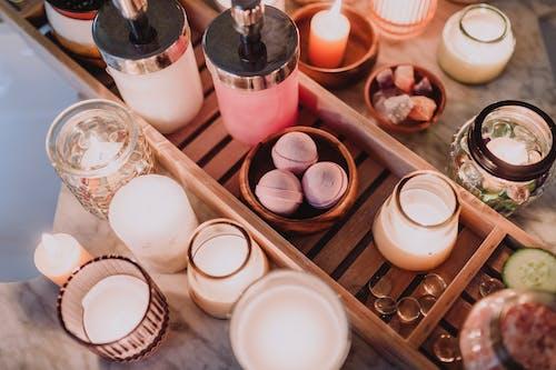 White and Brown Ceramic Mug on Brown Wooden Shelf
