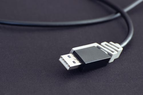 White Usb Cable on Black Surface