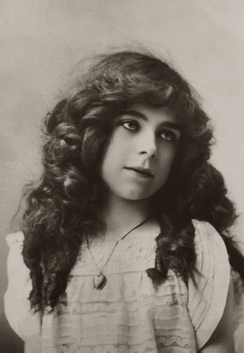 Portrait Of Girl With Long Curly Hair And Makeup