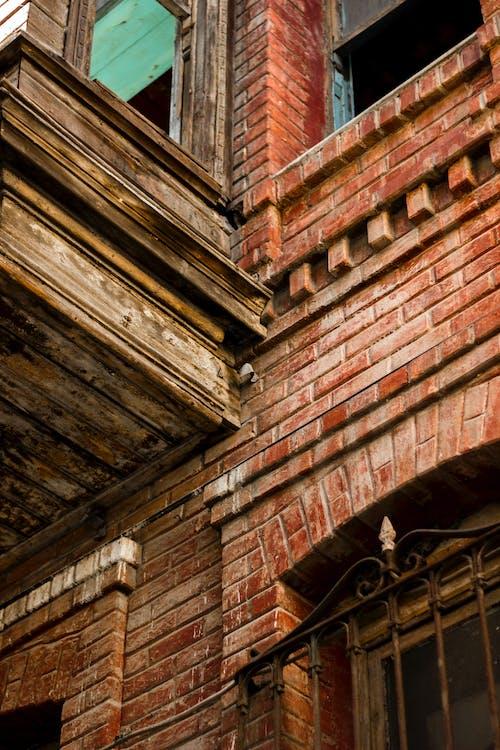 Brown Brick Wall With Brown Wooden Door