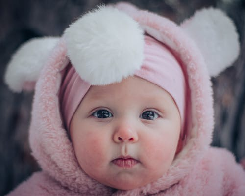 Baby in White Knit Cap