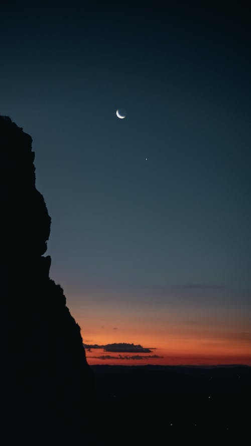 Silhouette of Rock Formation during Night Time