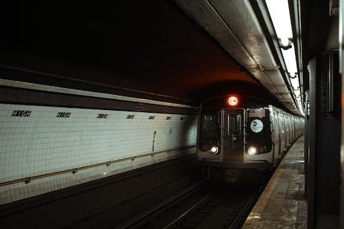 Train riding on railroad station