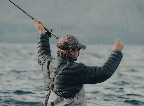 Man in Black Jacket Fishing
