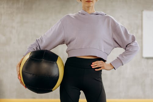 Crop Photo Of Woman Holding An Exercise Ball
