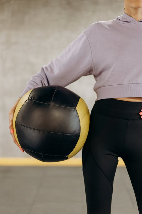 Crop Photo Of A Woman Holding An Exercise Ball