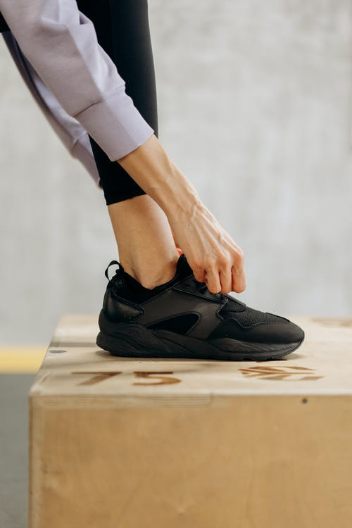 Person Wearing Black Rubber Shoes