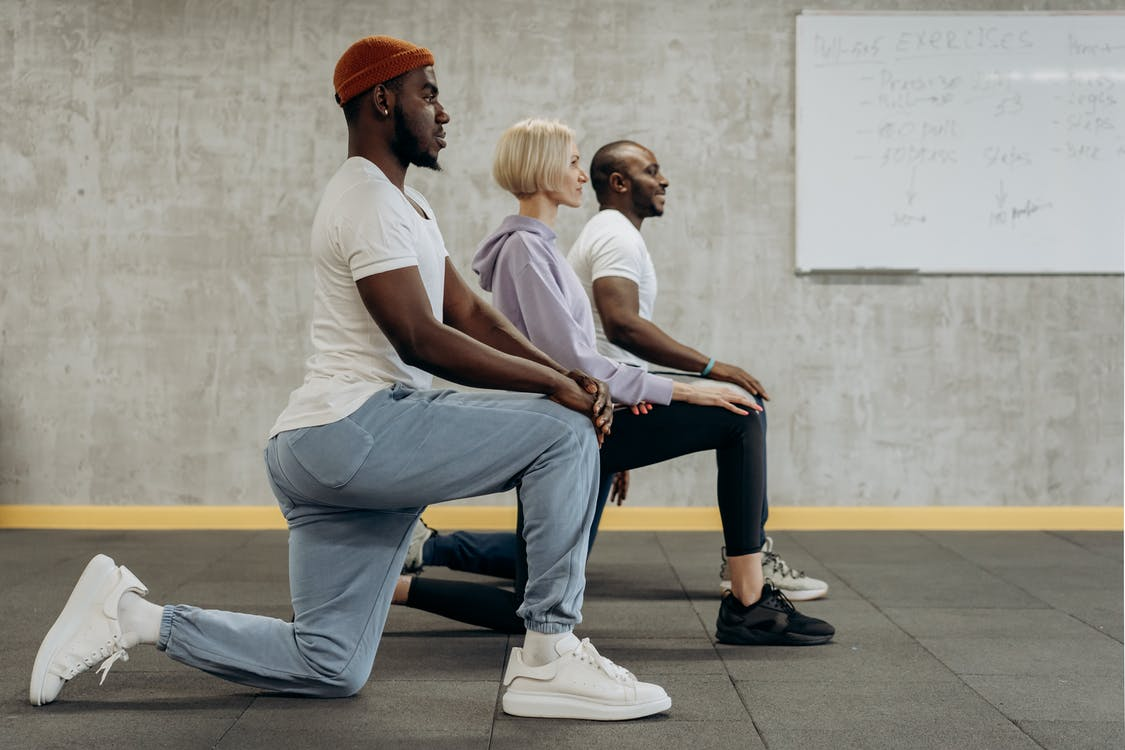 Three People In A Kneeling Position