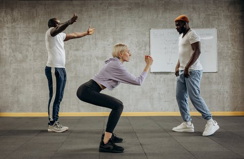 Three People Doing Exercise With Different Positions