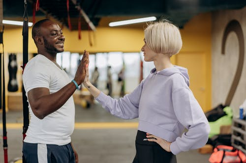 Man And Woman Doing High Five