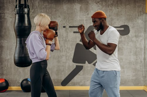 Man And Woman Doing Punching Exercise