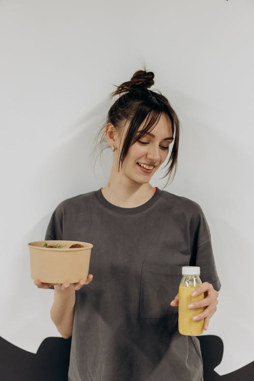 Woman Holding Food And Drink