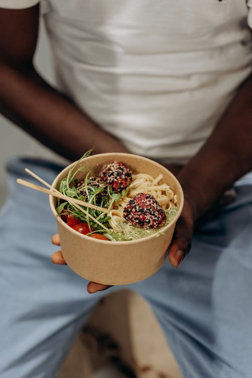 Person Holding A Bowl Of Healthy Food