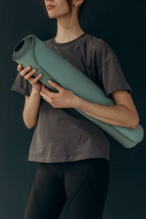 Crop Photo Of Woman With Yoga Mat