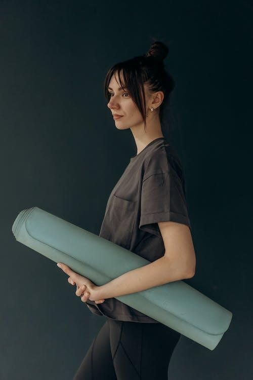 Woman Holding A Yoga Mat