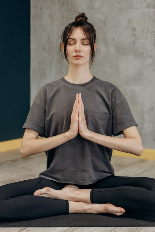 Woman Sitting In A Yoga Position