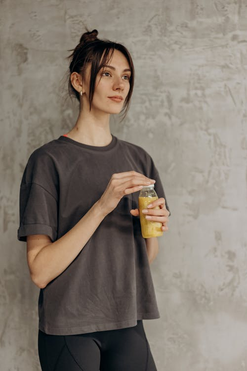 Woman Holding A Bottle Of Juice