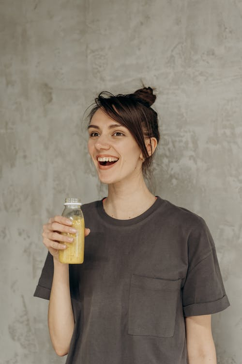 Woman Holding A Juice Drink