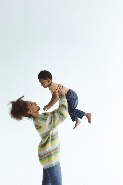 Mother carrying her Son Up High