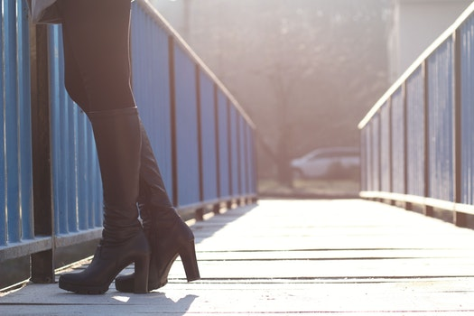 Woman Standing on Bridge