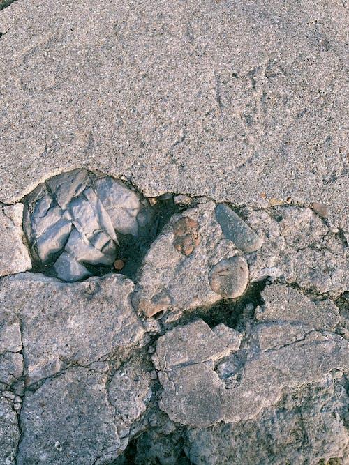 Gray Stone on Gray Concrete Floor