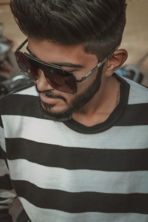 Man in Black and White Striped Crew Neck Shirt Wearing Black Sunglasses