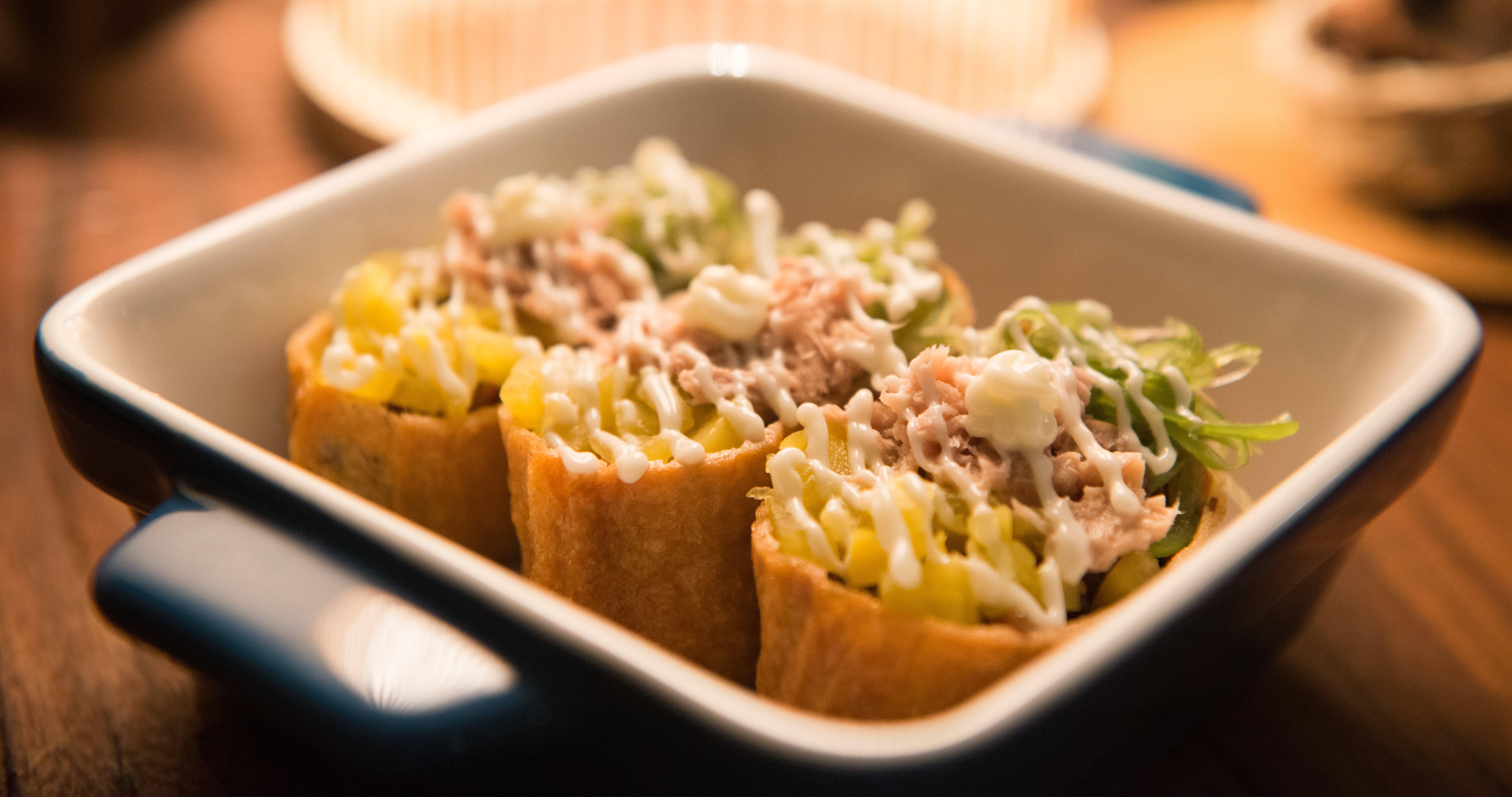 Three Tacos on Black And White Ceramic Bowl