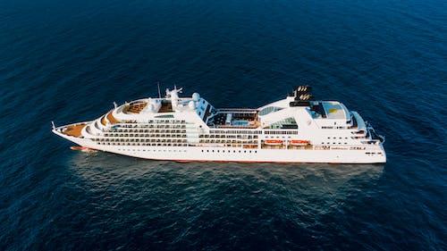 Modern cruise ship sailing in sea in sunlight