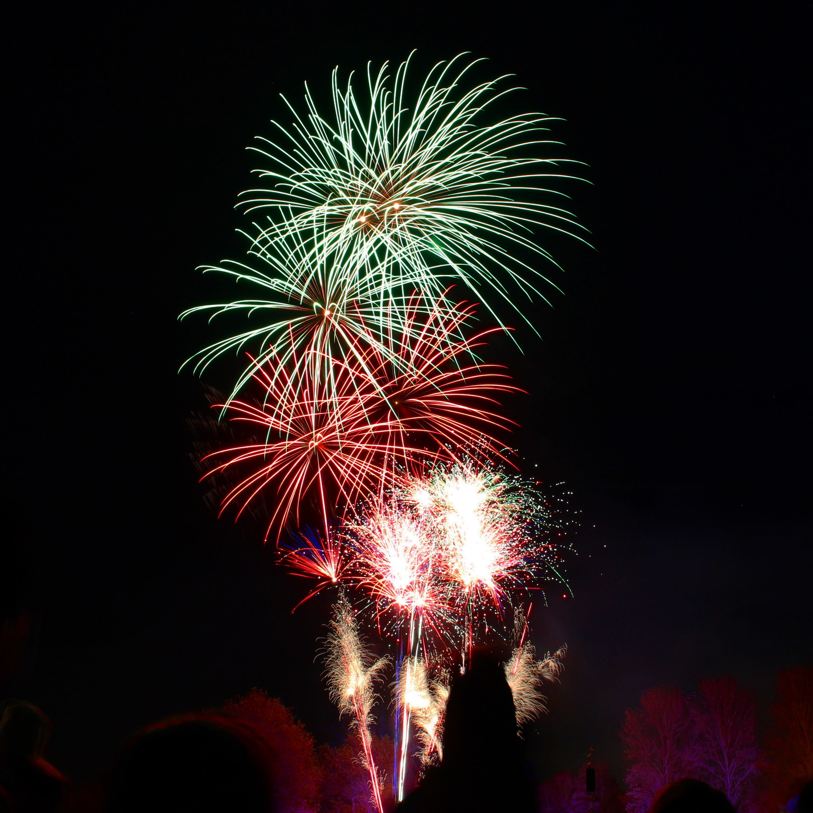 Photography of Green and Red Fire Works Display