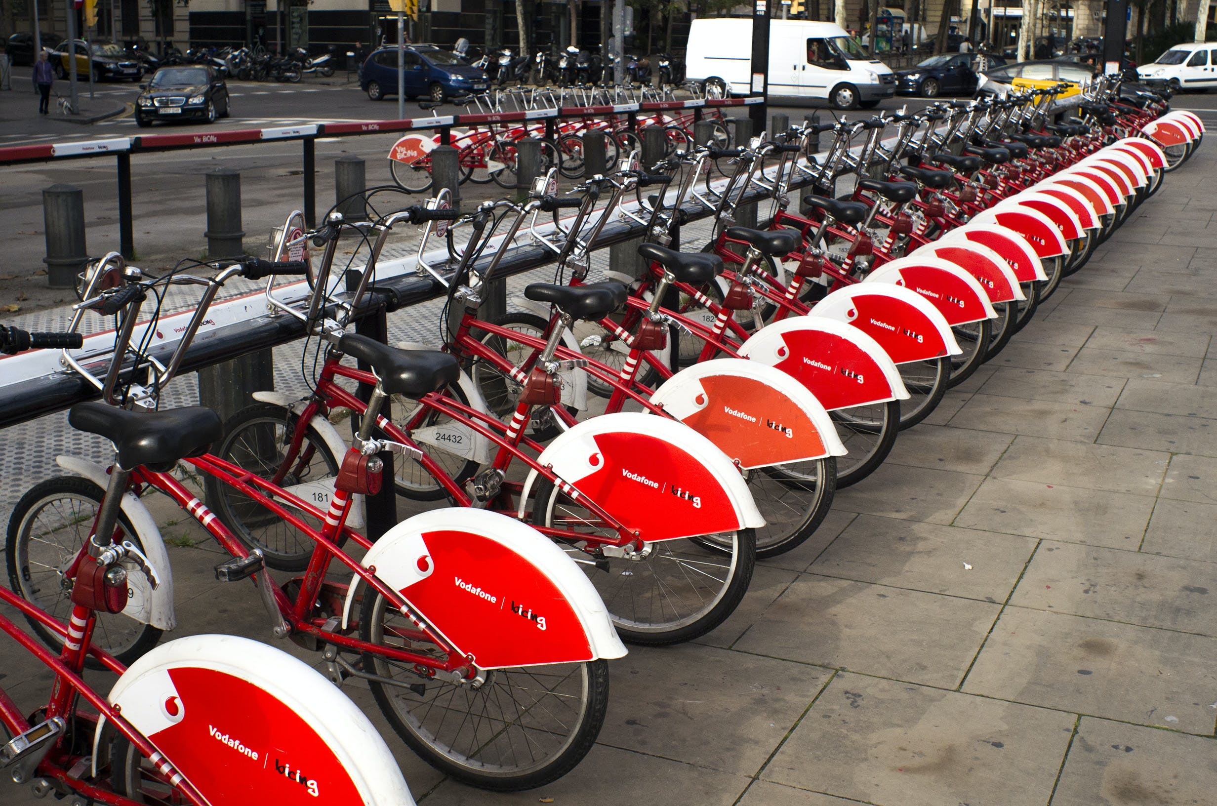 Parked Red and White Bicycles