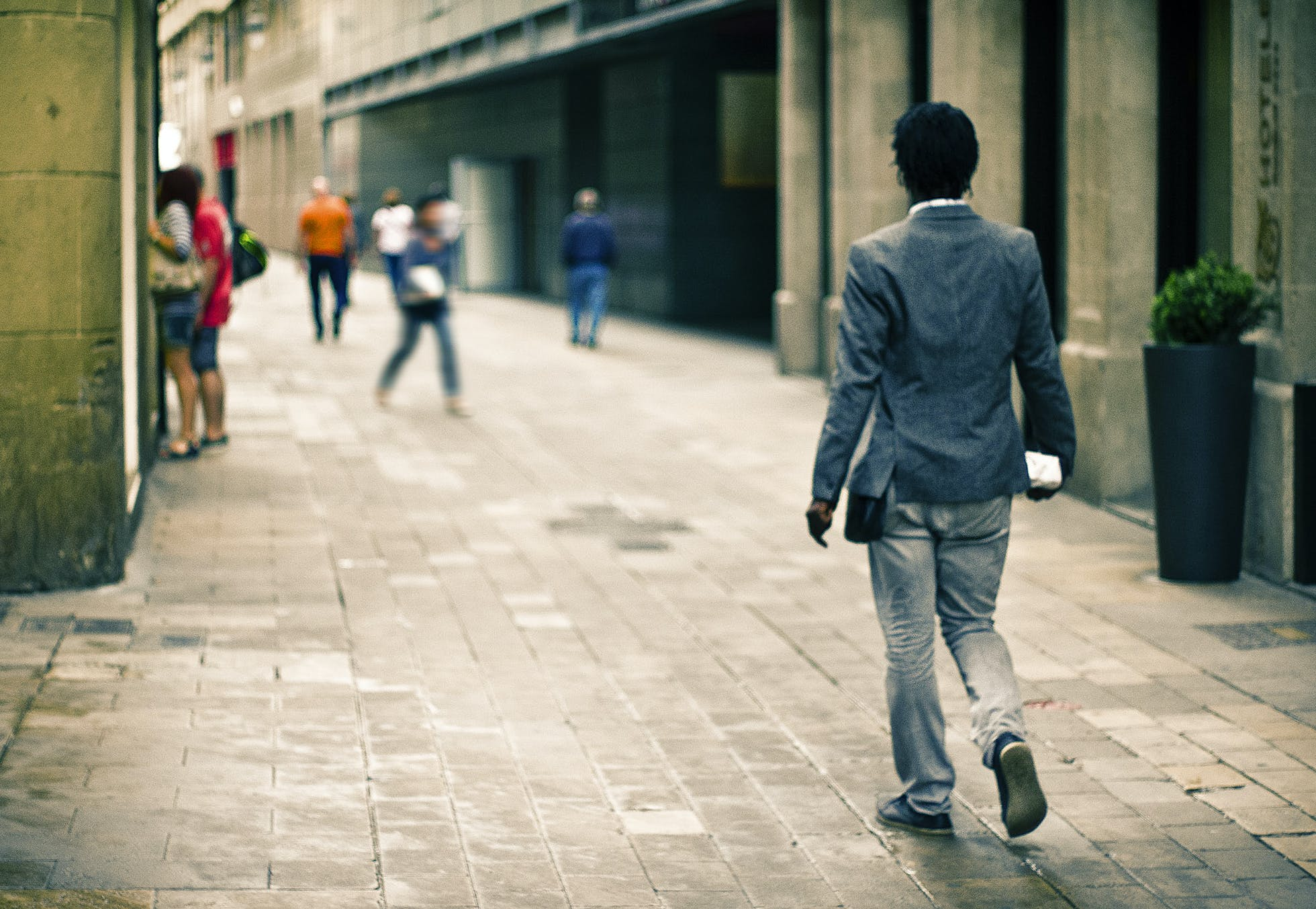 Man Wearing Gray Suit Jacket While on Pathway