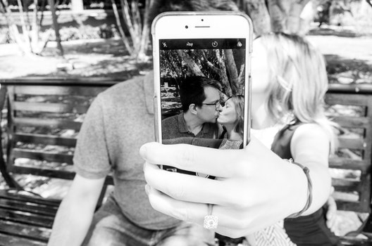 Gray Scale Photo of Man and Woman Taking a Selfie