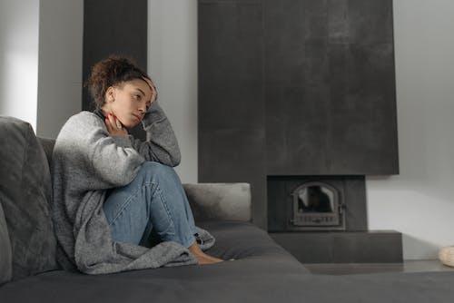 Sick Woman Sitting On A Sofa