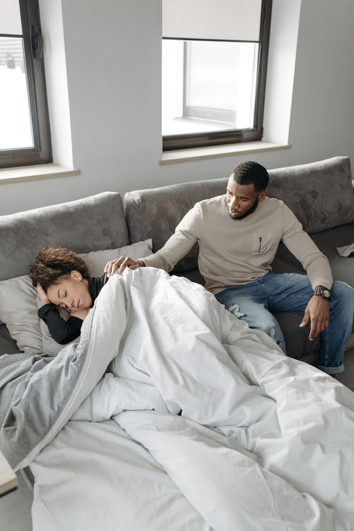Man Looking After Sick Woman