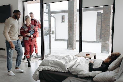 Paramedics Checking On A Woman